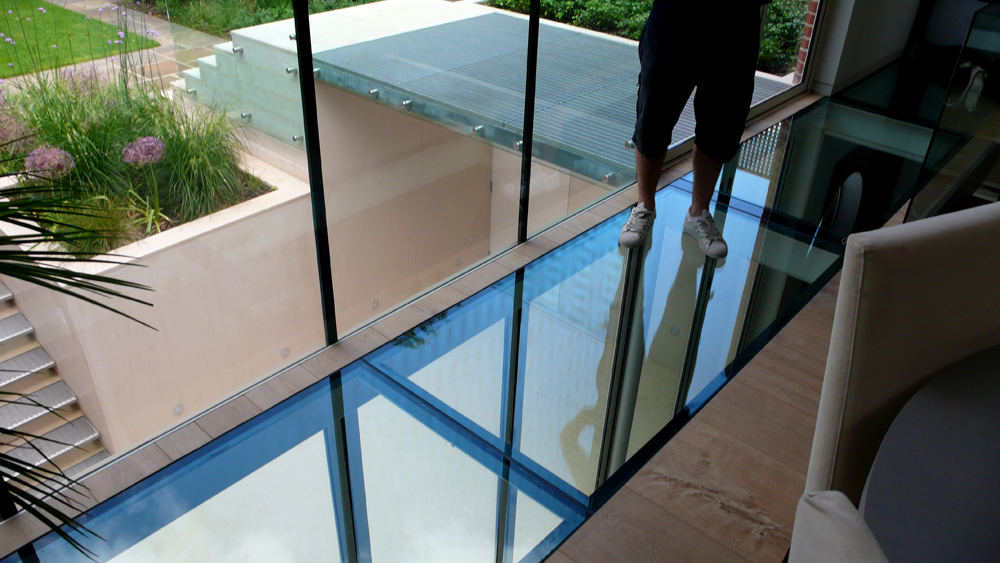 Check the glass floor inarch for Floor to ceiling glass panels